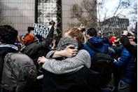 <p>On the street in Minneapolis, people who gathered in anticipation of the Chauvin verdict embrace each other as the guilty verdict is announced.</p>