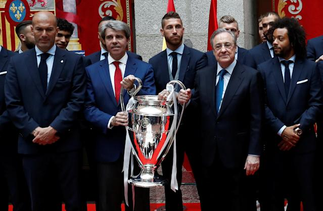 Soccer Football - Real Madrid celebrate winning the Champions League Final - Madrid, Spain - May 27, 2018 Real Madrid coach Zinedine Zidane with president Florentino Perez and the trophy during ceremony REUTERS/Javier Barbancho
