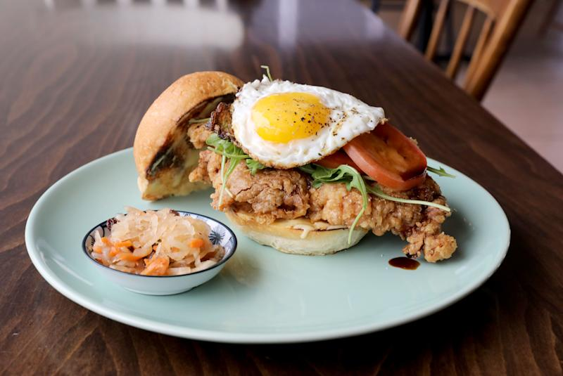 The Fried Crispy Chicken Sandwich, marinated in ginger and lime, with a sweet soy drizzle, calamansi mayo and a fried egg, and atsara (pickled green papaya) at Karenderya restaurant on Main Street in Nyack, Jan. 16, 2019.