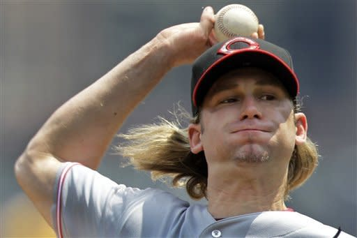 Cincinnati Reds pitcher Bronson Arroyo throws during the first inning of a baseball game against the Pittsburgh Pirates in Pittsburgh Monday, May 28, 2012. (AP Photo/Gene J. Puskar)