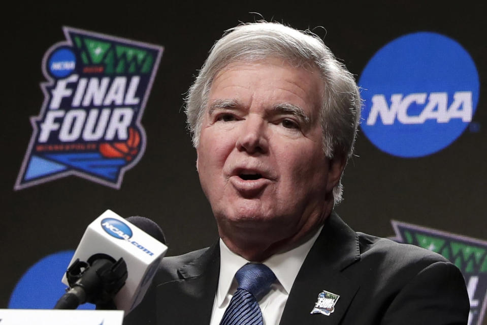 FILE - In this April 4, 2019, file photo, NCAA President Mark Emmert answers questions at a news conference at the Final Four college basketball tournament in Minneapolis. Emmert told the organization's more than 1,200 member schools Friday, June 18, 2021, that he will seek temporary rules as early as July to ensure all athletes can be compensated for their celebrity with a host of state laws looming and congressional efforts seemingly stalled. (AP Photo/Matt York, File)