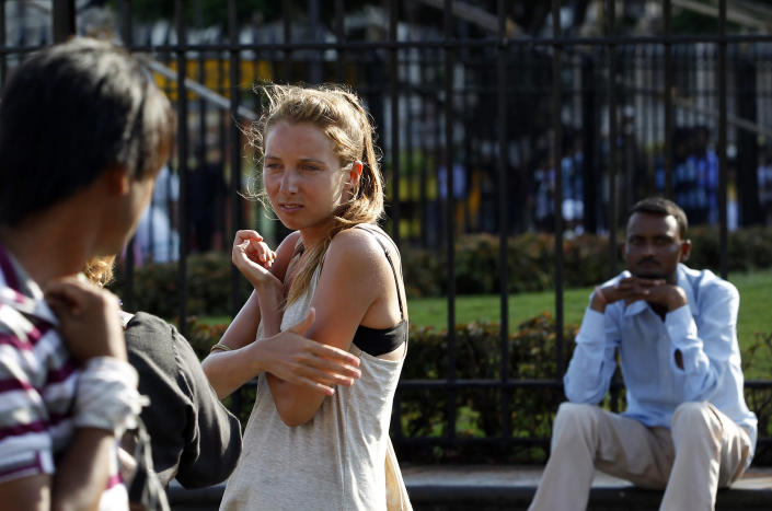 In this Tuesday, April 2, 2013 photo, German tourist Carolina De Paola, 22, walks near the landmark Gateway of India in Mumbai, India. A fatal gang rape in New Delhi didn't deter Germans De Paolo and Canan Wahner from traveling to India for a six-week tour. On a train, a man grabbed De Paolo's breasts from behind but she never reported the crime, deciding there would be no point. Violence against women, and the huge publicity generated by recent attacks here, is threatening India's $17.7 billion tourism industry with a new study showing tourism has plunged. (AP Photo/Rajanish Kakade)