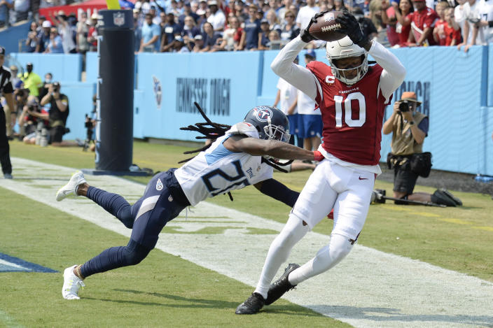 Arizona Cardinals wide receiver DeAndre Hopkins (10) catches a touchdown pass as he is defended by Tennessee Titans cornerback Jackrabbit Jenkins (20) in the first half of an NFL football game Sunday, Sept. 12, 2021, in Nashville, Tenn. (AP Photo/Mark Zaleski)