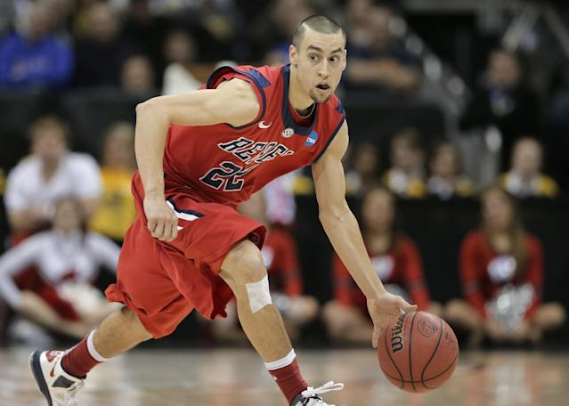 In this March 22, 2013, photo, Mississippi guard Marshall Henderson drives during a second-round game against Mississippi in the NCAA college basketball tournament in Kansas City, Mo. Henderson will return to the court for Saturday's game against Coastal Carolina after being suspended for the season opener. The Rebels hope the 6-foot-2 senior guard can add some scoring punch while keeping his behavior in check. AP Photo/Charlie Riedel)