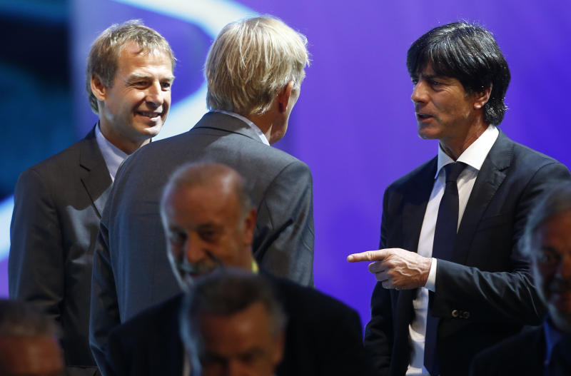 United States head coach Juergen Klinsmann from Germany, left, and Germany head coach Joachim Loew, right, talk to Cameroon head coach Volker Finke from Germany, center, after the draw ceremony for the 2014 soccer World Cup in Costa do Sauipe near Salvador, Brazil, Friday, Dec. 6, 2013. (AP Photo/Victor R. Caivano)