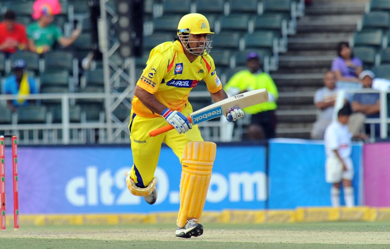Chennai Super Kings batsman MS Dhoni runs during a Group B match of The Champions League T20 (CLT20) against Sydney Sixers at Wanderers Stadium in Johannesburg on October 14, 2012.  AFP PHOTO / ALEXANDER JOE