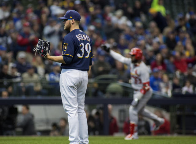 Milwaukee Brewers pitcher Corbin Burnes, left, gives up a home run to St. Louis Cardinals' Marcell Ozuna, right, during the second inning of a baseball game Wednesday, April 17, 2019, in Milwaukee. (AP Photo/Darren Hauck)
