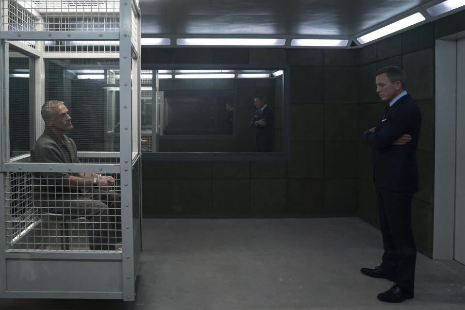 James Bond (Daniel Craig) visits Blofeld (Christoph Waltz) in his prison cell in NO TIME TO DIE. (Credit: Nicola Dove. © 2019 DANJAQ, LLC AND MGM)