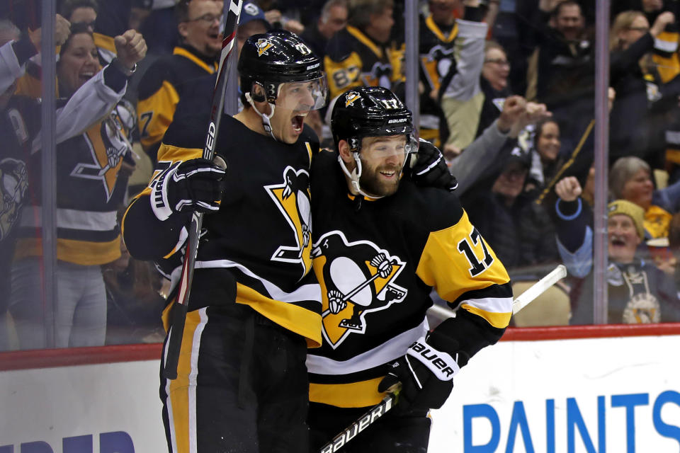 Pittsburgh Penguins' Bryan Rust (17) celebrates his goal with Evgeni Malkin (71), who had an assist, during the second period of the team's NHL hockey game against the Minnesota Wild in Pittsburgh, Tuesday, Jan. 14, 2020. (AP Photo/Gene J. Puskar)