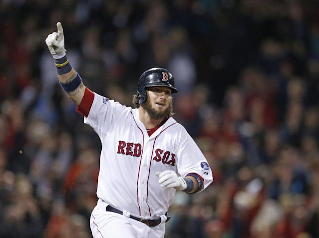 Boston Red Sox's Jarrod Saltalamacchia reacts after hitting the game winning single in the ninth inning during Game 2 of the American League baseball championship series against the Detroit Tigers Sunday, Oct. 13, 2013, in Boston. (AP Photo/Elise Amendola)