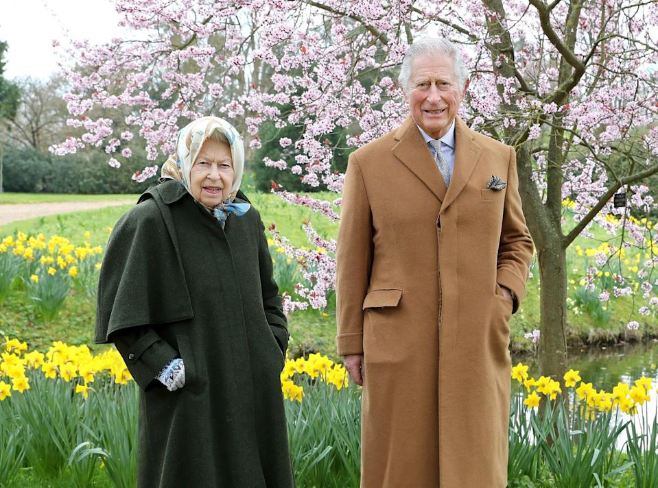 In this handout photograph taken on March 23, 2021 and released by Buckingham Palace on April 2, 2021,  Britain's Queen Elizabeth II and Britain's Prince Charles, Prince of Wales pose for a portrait in the garden of Frogmore House in Windsor, England.