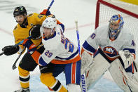 New York Islanders center Brock Nelson (29) defends against Boston Bruins center David Krejci (46) as Islanders goaltender Semyon Varlamov (40) protects the net in the first period of an NHL hockey game, Thursday, April 15, 2021, in Boston. (AP Photo/Elise Amendola)