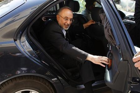 Iran's Foreign Minister Ali Akbar Salehi reacts upon his arrival to attend the official opening ceremony for the new headquarters of the Iranian embassy in Amman