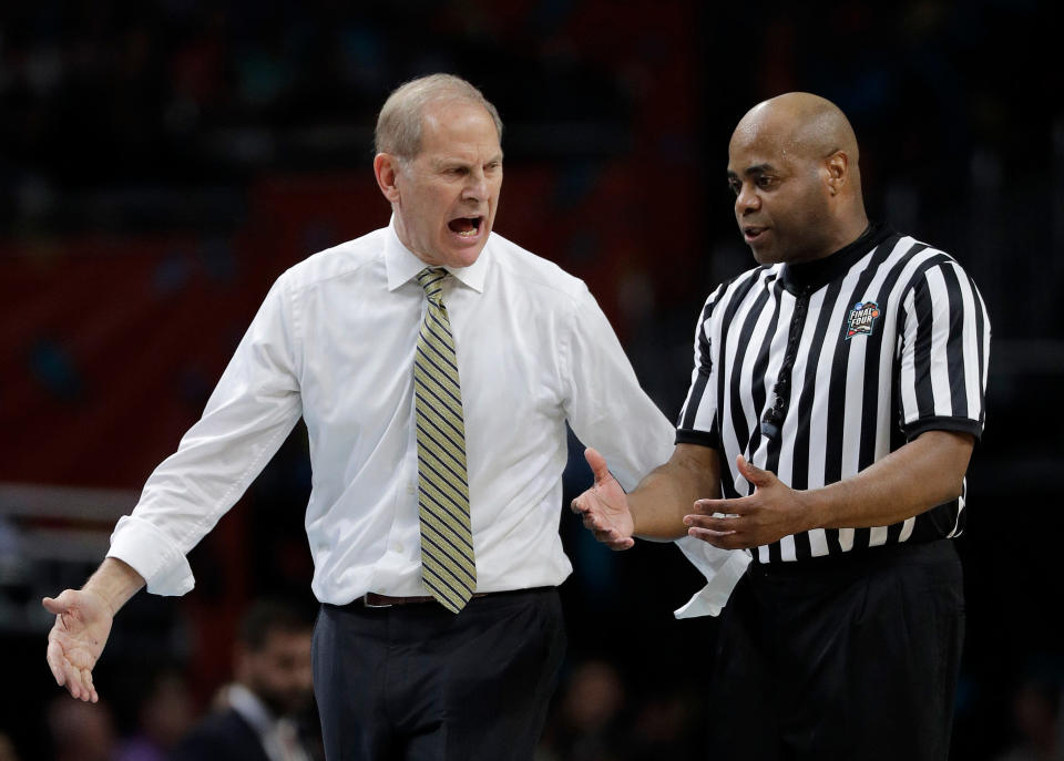 Michigan head coach John Beilein argues a call with a referee during the first half in the championship game of the Final Four NCAA college basketball tournament against Villanova. (AP)