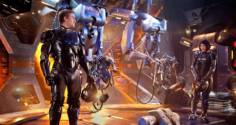 """This film image released by Warner Bros. Pictures shows Charlie Hunnam as Raleigh Becket, left, and Rinko Kikuchi as Mako Mori in a scene from """"Pacific Rim."""" (AP Photo/Warner Bros. Pictures, Kerry Hayes)"""
