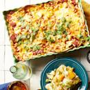 <p>Skip rolling and just layer these quick and easy enchiladas. This recipe uses a quick blender sauce, but if you're short on time, pick up a can of your favorite red enchilada sauce in the international aisle of your grocery store--you'll need about 3 cups.</p>