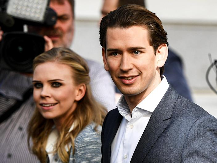 Austrian Peoples Party leader Sebastian Kurz and his girlfriend Susanne Thier cast their votes at a polling station in Vienna: EPA