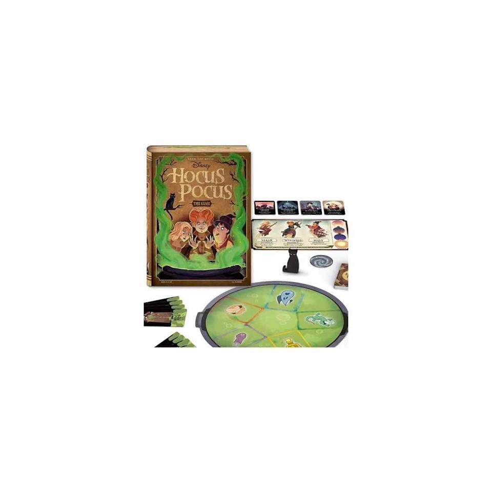 """<p><strong>Ravensburger</strong></p><p>amazon.com</p><p><strong>$12.09</strong></p><p><a href=""""https://www.amazon.com/dp/B086B89SB4?tag=syn-yahoo-20&ascsubtag=%5Bartid%7C10072.g.33543751%5Bsrc%7Cyahoo-us"""" rel=""""nofollow noopener"""" target=""""_blank"""" data-ylk=""""slk:Shop Now"""" class=""""link rapid-noclick-resp"""">Shop Now</a></p><p>Try your hand at this fun, cooperative card game based on the <a href=""""https://www.oprahmag.com/entertainment/tv-movies/g27968094/best-halloween-movies-on-netflix/"""" rel=""""nofollow noopener"""" target=""""_blank"""" data-ylk=""""slk:hit Halloween movie"""" class=""""link rapid-noclick-resp"""">hit Halloween movie</a> <em>Hocus Pocus</em>. Players work together to stop the infamous Sanderson sisters from completing their wicked potion before the sun rises.</p>"""