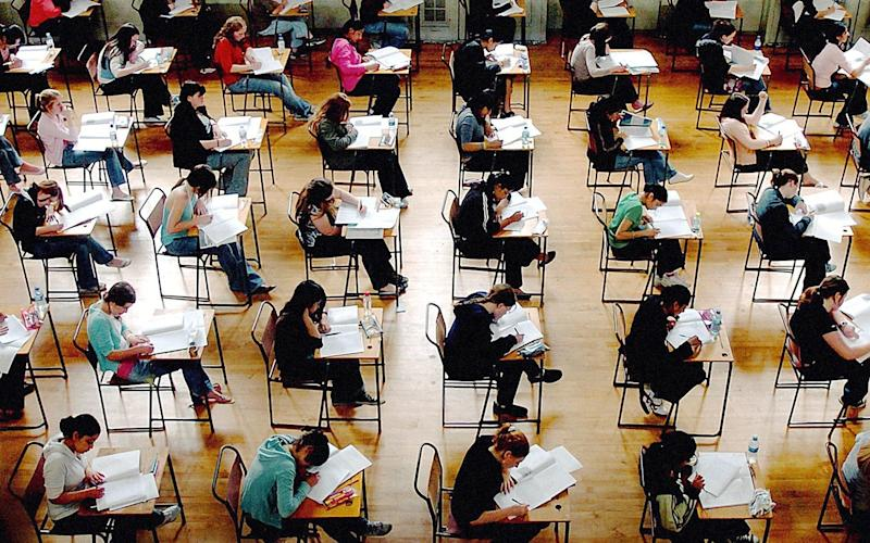 students sitting exams - PA