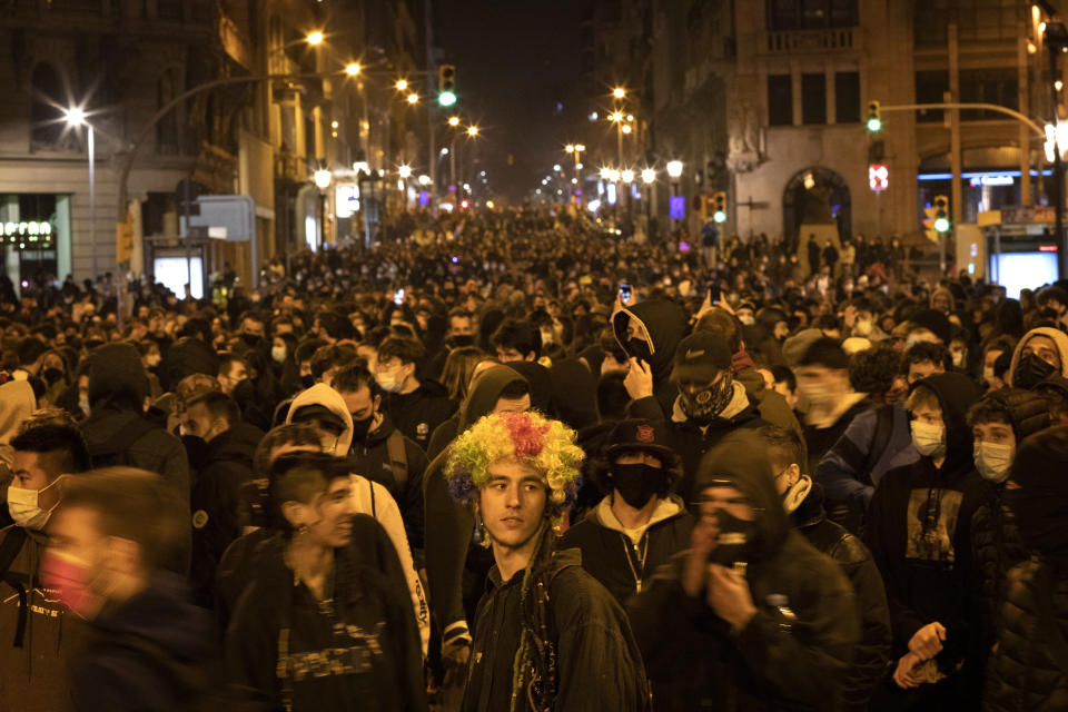 Demonstrators march during a protest condemning the arrest of rap artist Pablo Hasél in Barcelona, Spain, Friday, Feb. 19, 2021. The imprisonment of a rap artist for his music praising terrorist violence and insulting the Spanish monarchy has set off a powder keg of pent-up rage this week in Spain. The arrest of Pablo Hasél has brought thousands to the streets for different reasons. The majority march under the banner of freedom of speech, but Hasél's lyrics also tap into a debate about the role of Spain's parliamentary monarchy after financial scandals involving the royal house. (AP Photo/Emilio Morenatti)