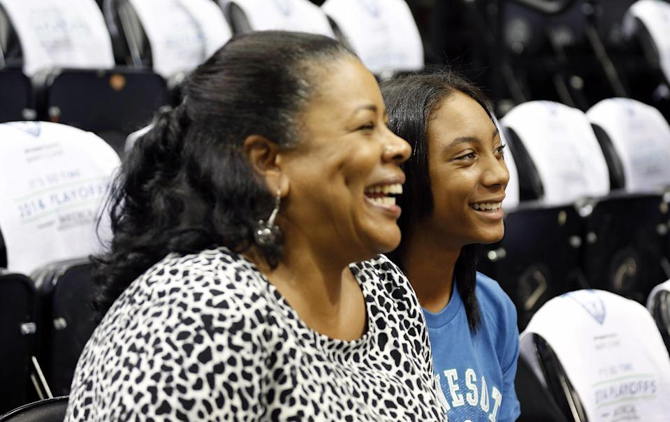 Thirteen-year-old Little League World Series pitcher Mo'Ne Davis, right, sits with WNBA President Laurel Richie prior to Game 2 of the WNBA basketball Western Conference finals between the Phoenix Mercury and the Minnesota Lynx, Sunday, Aug. 31, 2014, in Minneapolis. (AP Photo/Stacy Bengs)