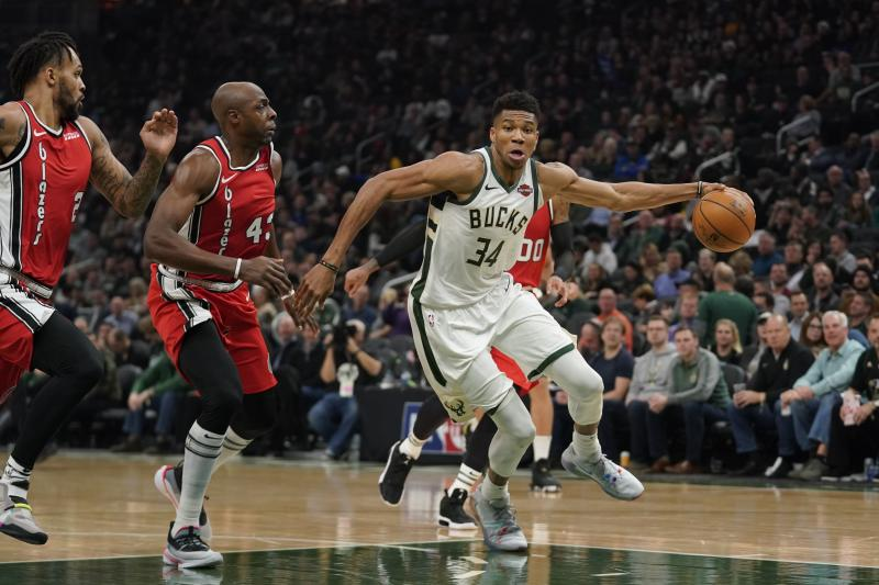 Milwaukee Bucks' Giannis Antetokounmpo drives past Portland Trail Blazers' Anthony Tolliver during the first half of an NBA basketball game Thursday, Nov. 21, 2019, in Milwaukee. (AP Photo/Morry Gash)