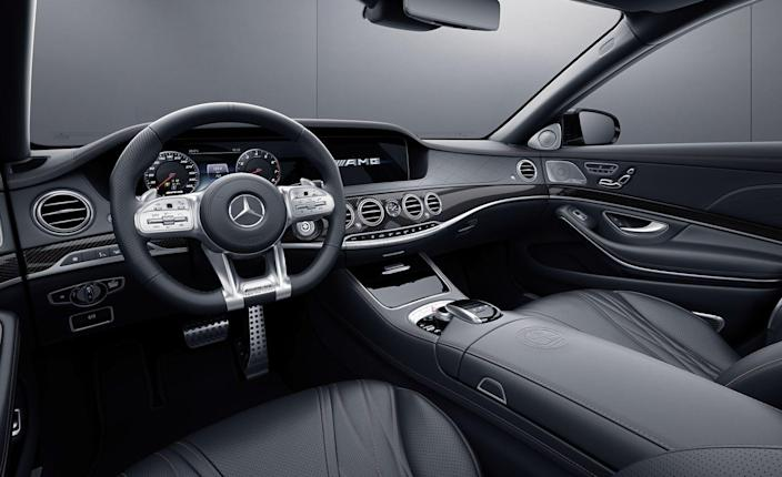 <p>Inside, Mercedes-AMG stylists have carried over the black and bronze theme in a subtle way by including black Nappa leather with bronze stitching, carbon fiber trim with black and bronze threads, copper-colored ambient lighting, and floor mats with bronze details.</p>