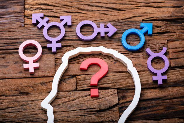 Question Mark Inside Persons Head Outline And Multiple Gender Signs Around (Photo: Getty)