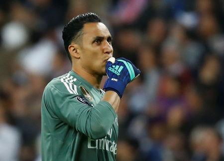 Soccer Football - Champions League Semi Final Second Leg - Real Madrid v Bayern Munich - Santiago Bernabeu, Madrid, Spain - May 1, 2018 Real Madrid's Keylor Navas celebrates after Karim Benzema scores their second goal REUTERS/Kai Pfaffenbach