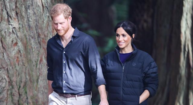 Meghan Markle paused her New Year's Day hike with Prince Harry to take a photo of a couple struggling with a selfie stick [Image: Getty]