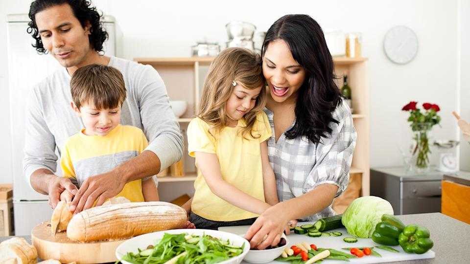family cooking a healthy dinner together