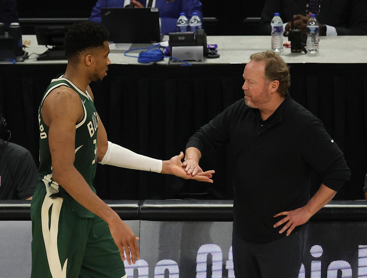 MILWAUKEE, WISCONSIN - JULY 11: Giannis Antetokounmpo #34 of the Milwaukee Bucks gets a high five from head coach Mike Budenholzer of the Milwaukee Bucks during the second half in Game Three of the NBA Finals against the Phoenix Suns at Fiserv Forum on July 11, 2021 in Milwaukee, Wisconsin. NOTE TO USER: User expressly acknowledges and agrees that, by downloading and or using this photograph, User is consenting to the terms and conditions of the Getty Images License Agreement. (Photo by Jonathan Daniel/Getty Images)