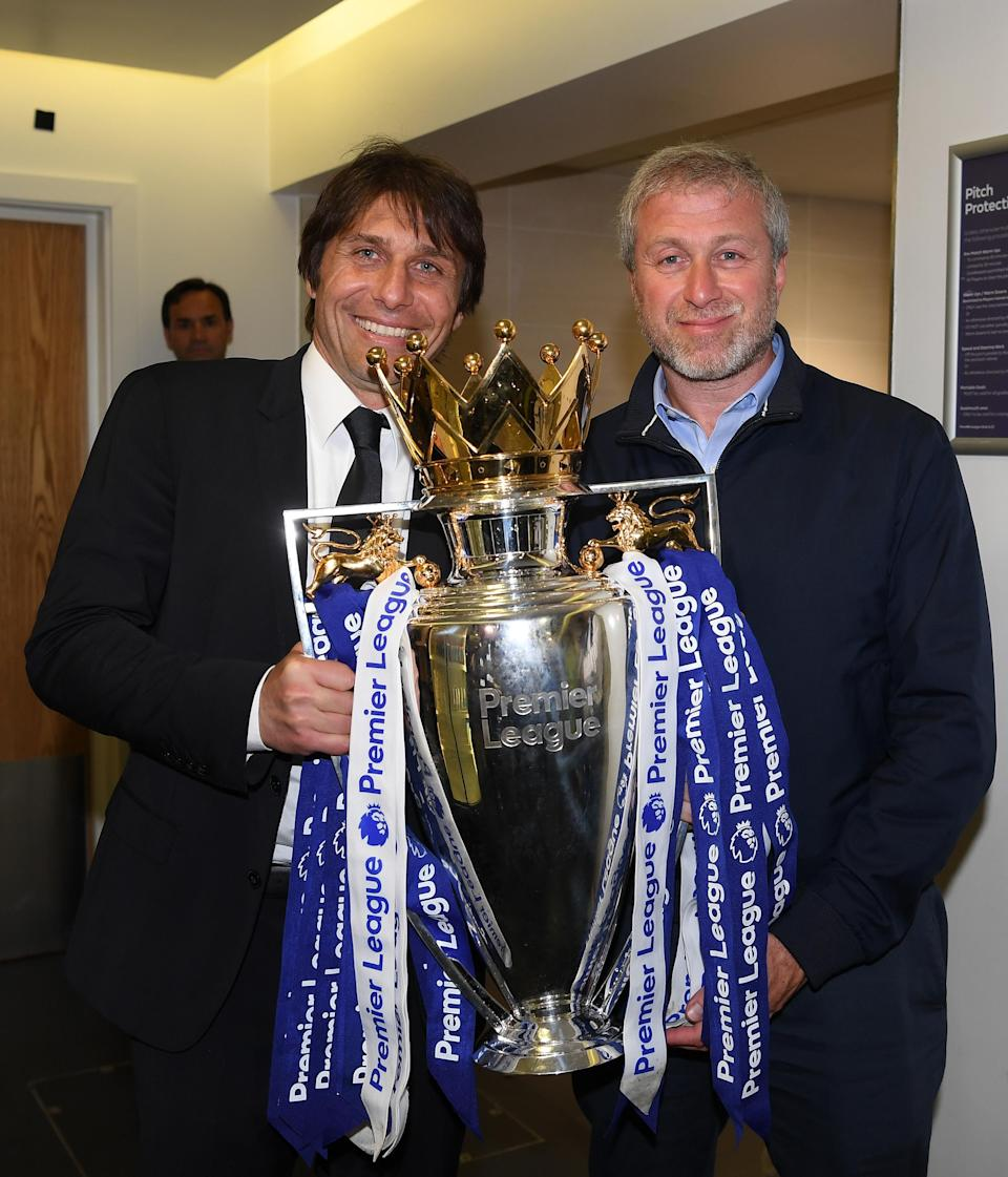 In happier times: Conte and Abramovich with the Premier League trophy