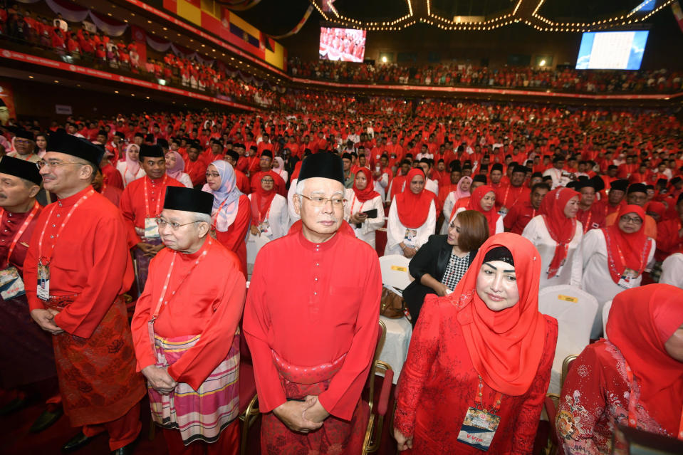 Former Malaysian Prime Minister Najib Razak, center, attends United Malays National Organization's (UMNO) general assembly in Kuala Lumpur, Malaysia, on Sept. 29, 2018. Najib was found guilty Tuesday, July 28, 2020 in his first corruption trial linked to one of the world's biggest financial scandals - the billion-dollar looting of the 1MDB state investment fund. (AP Photo)