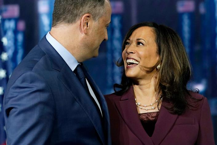 Democratic vice presidential candidate Sen. Kamala Harris, D-Calif., is joined on stage by her husband Doug Emhoff after she spoke during the third day of the Democratic National Convention, Wednesday, Aug. 19, 2020, at the Chase Center in Wilmington, Del.