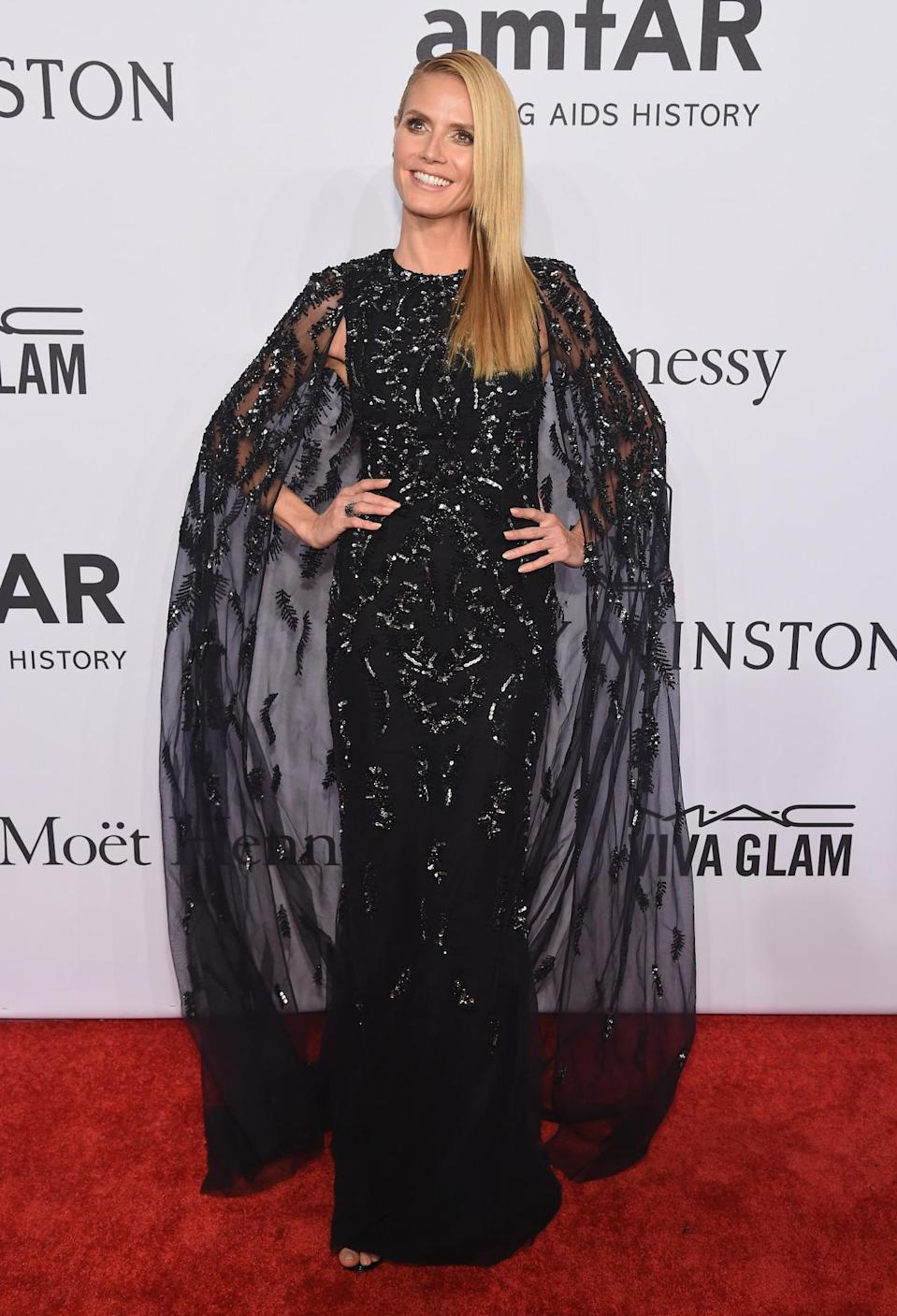 <p>Klum made sure all eyes were on her in this divine beaded number (complete with dramatic cape) by Zuhair Murad. <i>[Photo: Getty]</i><br></p>