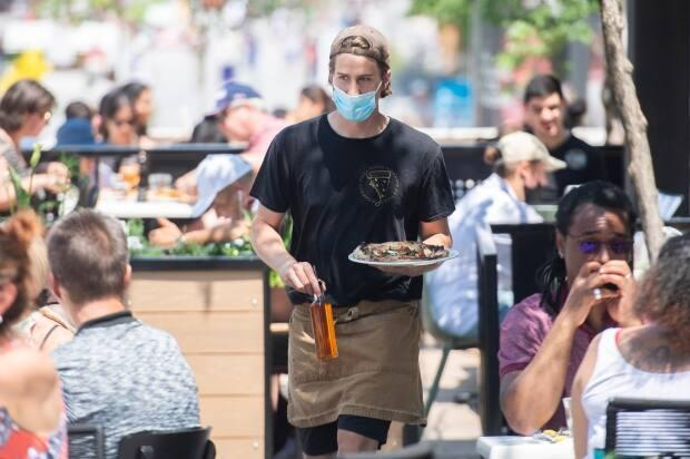 Montreal restaurants will open dining rooms for the first time since September on Monday. (Graham Hughes/The Canadian Press - image credit)
