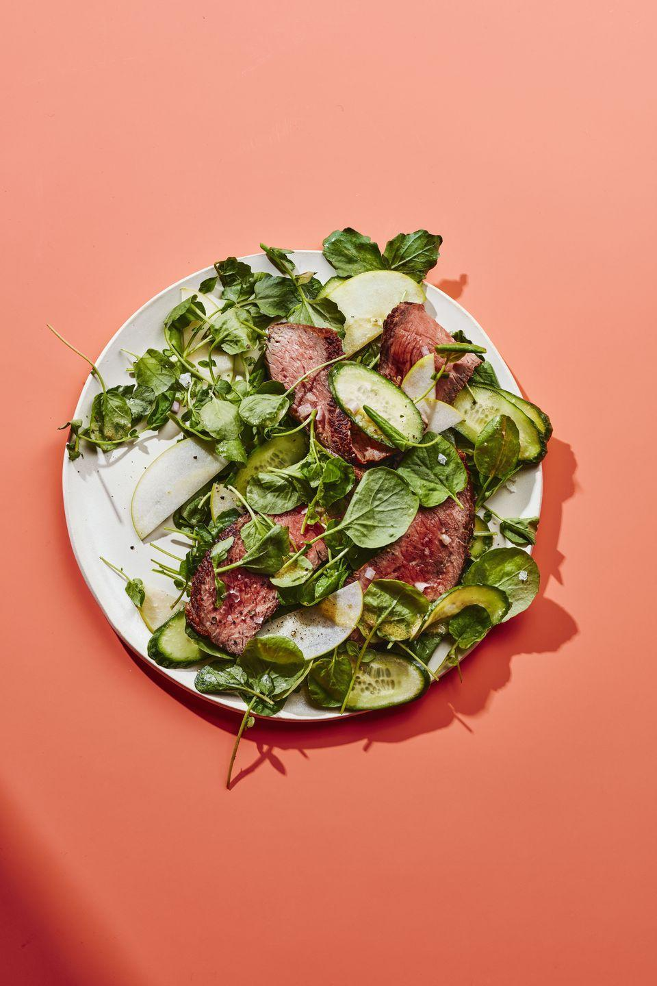 """<p>Give your go-to lettuce a rest and toss in a few different kinds of greens instead. Add mixed herbs (entire leaves or chopped), microgreens, and sprouts, or shredded cabbage or Brussels sprouts. A few <a href=""""https://www.womansday.com/food-recipes/food-drinks/g2523/summer-salads/"""" rel=""""nofollow noopener"""" target=""""_blank"""" data-ylk=""""slk:salad options"""" class=""""link rapid-noclick-resp"""">salad options</a> when it comes to thinking beyond kale and romaine:<strong><br><br>•Mustard greens</strong> have a peppery taste and are packed with vitamin K, which helps with blood clotting, plus calcium and iron.<br><br><strong>•Watercress leaves</strong> are delicate, but they're a rich source of antioxidants like vitamin C and lutein, as well as vitamin A, crucial to good eye health.<br><br><strong>•Arugula</strong> is great for gut health—it contains sulforaphane, which may ease constipation, and also folate, a B vitamin that helps the body digest carbs.<br><br>Finally, try topping with crispy chickpeas instead of croutons for crunch; something sweet, like pears, apples, or grapes; or a dressing that spices things up—we're looking at you, horseradish.<br></p><p><strong>Start by trying the recipes for <a href=""""https://www.womenshealthmag.com/food/a33863942/steak-apple-watercress-salad-recipe/"""" rel=""""nofollow noopener"""" target=""""_blank"""" data-ylk=""""slk:Watercress Steak Salad with Horseradish Vinaigrette"""" class=""""link rapid-noclick-resp"""">Watercress Steak Salad with Horseradish Vinaigrette</a> and <a href=""""https://www.womenshealthmag.com/food/a29135611/impossible-bratwurst-apple-salad-with-caraway-vinaigrette/"""" rel=""""nofollow noopener"""" target=""""_blank"""" data-ylk=""""slk:Vegan Bratwurst Salad with Caraway Vinaigrette"""" class=""""link rapid-noclick-resp"""">Vegan Bratwurst Salad with Caraway Vinaigrette</a>. </strong> </p>"""