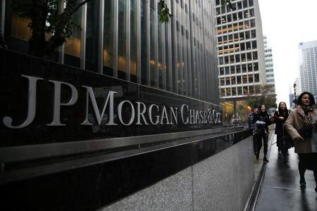 FILE PHOTO - A sign of JP Morgan Chase Bank is seen in front of their headquarters tower in Manhattan, New York, U.S., November 13, 2017. REUTERS/Amr Alfiky