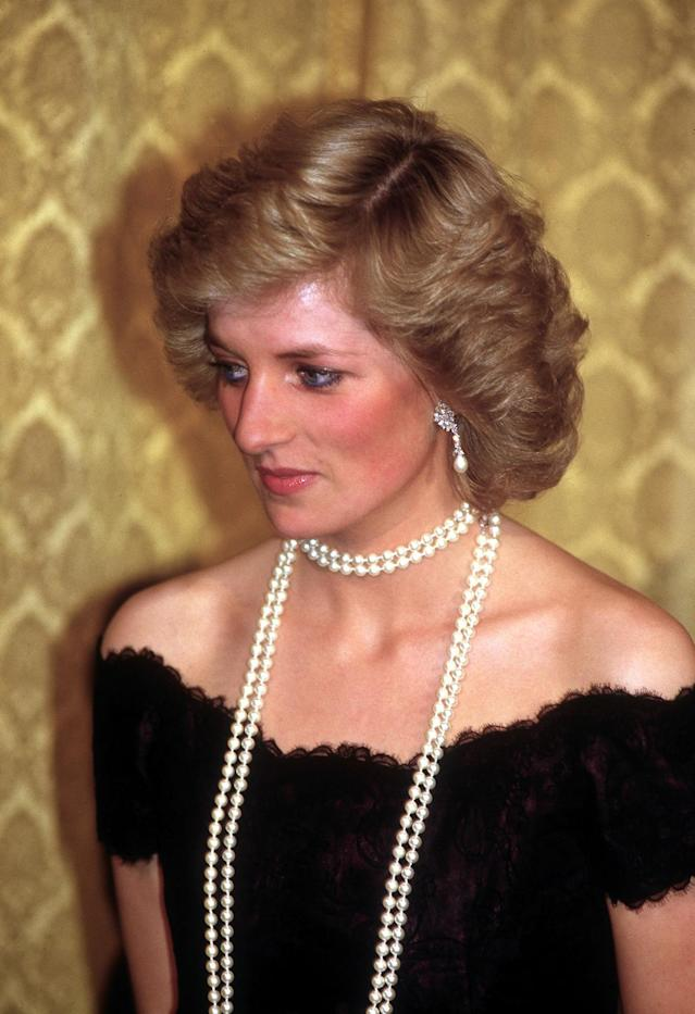 <p>Diana didn't save the long strands of pearls for movie premieres but wore another string while attending a dinner in Hamburg, Germany, in November 1987. (Photo: Jayne Fincher/Getty Images) </p>