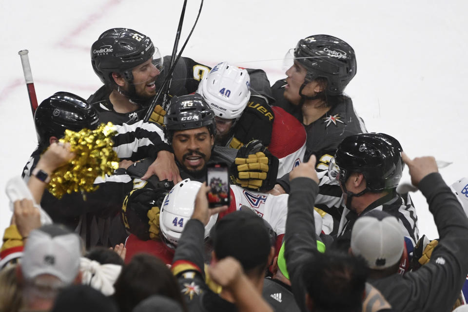 Players try separating Vegas Golden Knights right wing Ryan Reaves (75), Montreal Canadiens defenseman Joel Edmundson (44) and Canadiens right wing Joel Armia (40) during the second period in Game 2 of an NHL hockey Stanley Cup semifinal playoff series, Wednesday, June 16, 2021, in Las Vegas. (AP Photo/David Becker)