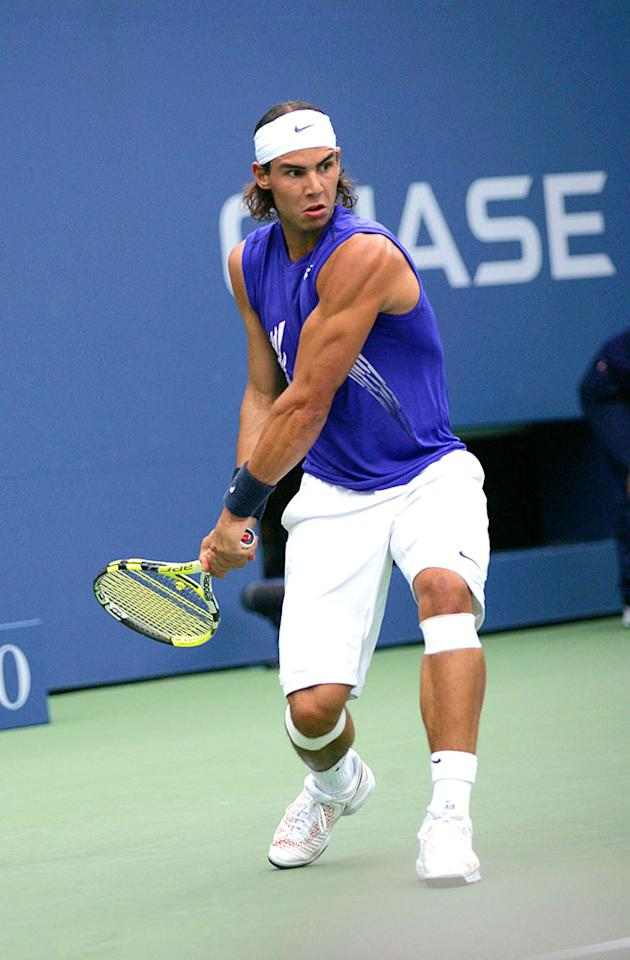 "Muscley masterpiece Rafael Nadal takes a swing at winning his first U.S. Open beginning this week. Go Rafa! ST/<a href=""http://www.splashnewsonline.com"" target=""new"">Splash News</a> - August 25, 2008"