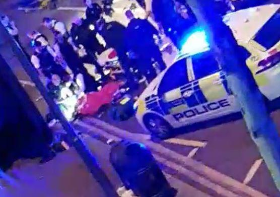 Handout screengrab from video of police and ambulance services treating someone at the scene in Leyton, east London, where an officer was stabbed shortly before midnight after attempting to stop a van.