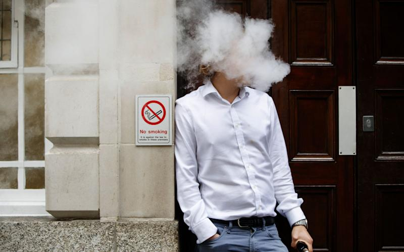 Tobacco alternatives, such as e-cigarettes and heat-not-burn products, have been touted to be 90 to 95 per cent less harmful than their combustible counterparts. (AFP via Getty Images file photo)