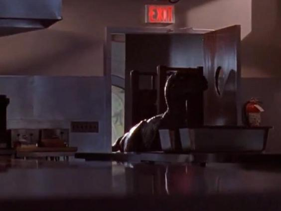 An operator's hand can be seen holding the dinosaur's tail in this 'Jurassic Park' scene (Universal Pictures)