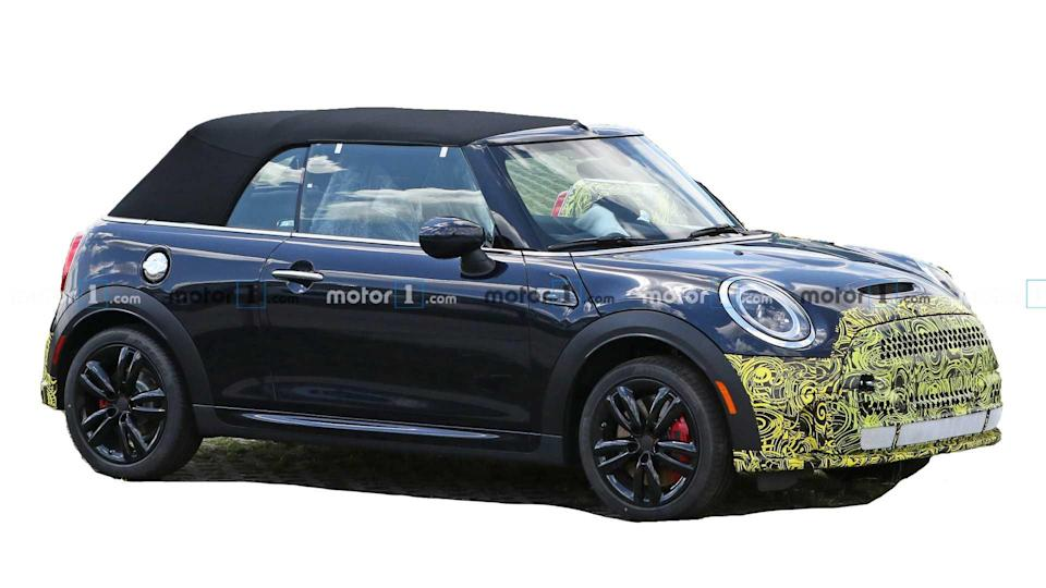 """<p>Like other models in the lineup, the Mini Convertible is getting a slight refresh that includes a revised front end.</p> <h3><a href=""""https://www.motor1.com/news/433702/mini-cooper-convertible-spy-photos/"""" rel=""""nofollow noopener"""" target=""""_blank"""" data-ylk=""""slk:Mini Cooper Convertible Spied Hiding Its Mild Facelift"""" class=""""link rapid-noclick-resp"""">Mini Cooper Convertible Spied Hiding Its Mild Facelift</a></h3> <br><a href=""""https://www.motor1.com/news/431823/mini-cooper-se-5-door-facelift/"""" rel=""""nofollow noopener"""" target=""""_blank"""" data-ylk=""""slk:Mini Cooper SE Five-Door Facelift Spied For The First Time"""" class=""""link rapid-noclick-resp"""">Mini Cooper SE Five-Door Facelift Spied For The First Time</a><br><a href=""""https://www.motor1.com/news/431278/mini-facelift-spy-photos/"""" rel=""""nofollow noopener"""" target=""""_blank"""" data-ylk=""""slk:Mini Cooper Hardtop Spied Showing Sportier Look"""" class=""""link rapid-noclick-resp"""">Mini Cooper Hardtop Spied Showing Sportier Look</a><br>"""