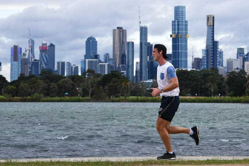 People are seen exercising at Albert Park in Melbourne.