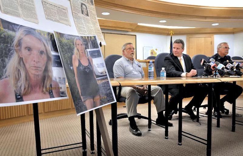 Sitting in front of a display of news articles and photos of Brenda Heist, from left, her ex-husband, Lee Heist, Detective Sgt. John Schofield and Lititz Chief William Seace address a news conference in Litiz, Pa. on Wednesday, May 1, 2013. Brenda Heist, who mysteriously disappeared after dropping off her children for school 11 years ago, has surfaced in Florida, telling police she traveled there on a whim with homeless hitchhikers, slept under bridges and survived by scavenging food and panhandling, authorities said Wednesday. (AP Photo/Intelligencer Journal, Dan Marschka)