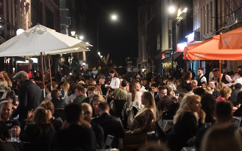Diners packed outdoor terraces in London last night for the last weekend before the tightening of restrictions - Peter Summers/Gett
