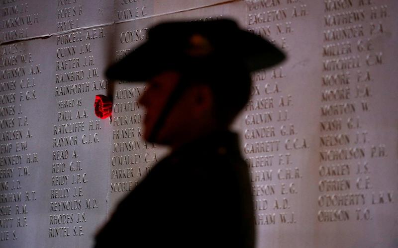 An Australian soldier attends the dawn service at the Australian National Memorial in Villers-Bretonneux, France, April 25, 2018 - REUTERS